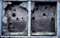 Broken window shattered glass windows with bullet holes and pieces Royalty Free Stock Image