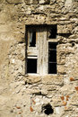 Broken windows and stone wall old Stock Photography