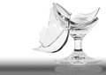 Broken wine glass is damaged. Stock Image