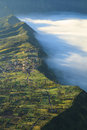 Bromo mountain in tengger semeru national park at sunrise east village and cliff volcano java indonesia Stock Photo