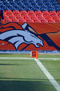 Broncos goal line close up shot of and end zone pylon with a large bronco as a back drop Royalty Free Stock Images