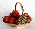 Bronze basket as centerpiece vintage gold with roses motif filled with organic red apples with shadows Stock Photo