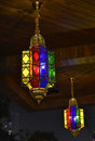 Bronze colored glass chandelier light up at night,bronze lighting decorated with red blue green Stock Photo