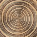 Bronze copper geometrical abstract ornament spiral fractal pattern background. Metal spiral pattern effect background swirl shape Royalty Free Stock Photo