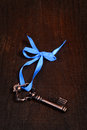 Bronze key with blue ribbon Royalty Free Stock Photo