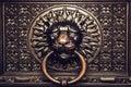 Bronze knocker with lion head Royalty Free Stock Photo
