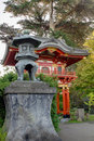 Bronze Lantern by Pagoda in Japanese Garden Royalty Free Stock Photos