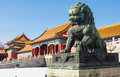 Bronze lion colorful building and golden roofs in the forbidden city beijing china Stock Image
