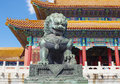 Bronze lion colorful building and golden roofs in the forbidden city beijing china Royalty Free Stock Photography