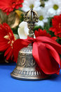 Bronze melodic bell with a red ribbon prom in coll Stock Image