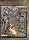 Bronze plague charles bridge prague landmark one of the two plaques on the statue of st john of nepomuk on in Royalty Free Stock Photography
