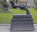 Bronze sculpture of oversized revolver with a knotted barrel