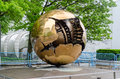 Bronze sculpture at un new york may one of the famous sphere within sphere sculptures by a pomodoro outside united nations Royalty Free Stock Image