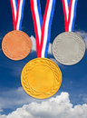 Bronze silver and golden medals with blue sky background Stock Photos