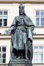 Bronze statue of the eleventh Czech King and Roman Emperor Charles IV. in night snowy Prague near Charles Bridge, Czech Republic Royalty Free Stock Photo