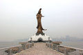 The bronze statue of goddess kun iam a buddhist deity of mercy situated on man made island in macau Royalty Free Stock Images