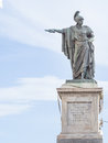 Bronze statue indicate in front of a staure of carlo felice in cagliari sardinia italy Stock Images