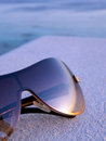 Bronze Tinted Sunglasses Reflecting Sunset Royalty Free Stock Photo
