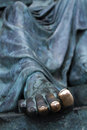 Bronze toes the of a statue polished by constant touching Stock Images