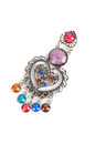 Brooch with different gems on a white Royalty Free Stock Photo