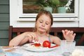 Brooding girl with her food on the plate Stock Images