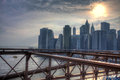 The Brooklyn Bridge with the Manhattan skyline behind at sunset Royalty Free Stock Photo
