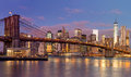 Brooklyn bridge and manhattan skyscrapers at sunrise new york time beautiful gentle colors of sky city illuminations usa Stock Image