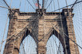 Brooklyn Bridge at New York City with American flag Royalty Free Stock Photo