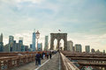 Brooklyn bridge in new york city may with pedestrians on may it s a and is one of the oldest Stock Photos