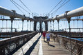 Brooklyn bridge new york city usa august tourists and new yorkers across the every day for sports sightseeing or simply to get to Stock Photos