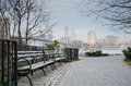 Brooklyn bridge park bench and walkway with manhat tranquil setting the lower manhattan as a backdrop as seen from the in dumbo Royalty Free Stock Photography