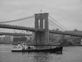 Brooklyn bridge from south street seaport a view of the famous taken in new york city a barge floats on the east river in the Stock Photography