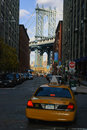 Brooklyn Bridge with yellow cab Stock Photography
