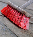 Broom old wooden on a stone floor Stock Photos
