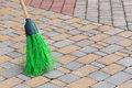 Broom tile a to clean the sidewalk tiles Royalty Free Stock Photos