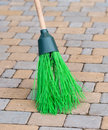 Broom tile a to clean the sidewalk tiles Royalty Free Stock Photography