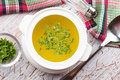 Broth in bowl fresh appetizing white on table selective focus Royalty Free Stock Images