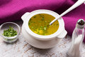Broth in bowl fresh appetizing white on table selective focus Stock Photography