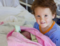 Brother meeting newborn sister in hospital Stock Images