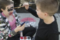 Brother painting sisters face Royalty Free Stock Photo