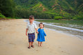 Brother and sister on beach in hawaii portrait of a young the oahu at kahana bay Stock Image