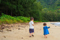 Brother and sister on beach in hawaii portrait of a young the oahu at kahana bay Royalty Free Stock Photography