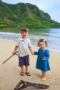 Brother and sister on beach in hawaii portrait of a young the oahu at kahana bay Royalty Free Stock Photos