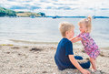 Brother and sister on the beach playing at st mawes cornwall uk Royalty Free Stock Photography