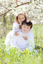 Brother and sister in a blossoming garden Royalty Free Stock Photo