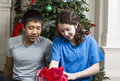 Brother and Sister Checking Holiday Gifts Stock Photos