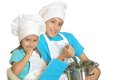 Brother and sister in chef uniforms cute posing Royalty Free Stock Photos