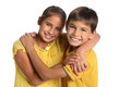 Brother and sister embracing portrait of young isolated over white background Royalty Free Stock Image