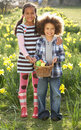 Brother And Sister Having Easter Egg Hunt Royalty Free Stock Images