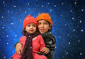 Brother and sister having fun in winter Royalty Free Stock Images